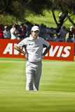 Padraig Harrington on the 17th Green. Padraig Harrington, resting his hands on his hips, reviewing the lie of the 17th green Royalty Free Stock Photos