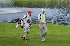 Padraig Harrington & Caddie - NGC2010 Immagine Stock