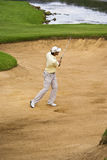 Padraig Harrington - Bunker Shot. Padraig Harrington, strikes the ball with a sand wedge to get out of the bunker & onto to the 17th green Stock Image