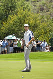 Padraig Harrington. Putter in hand, watching the ball after putting toward the hole, on the 1st green Royalty Free Stock Photos