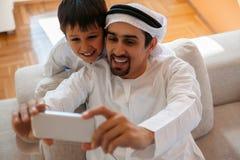 Padre árabe And Son Foto de archivo libre de regalías
