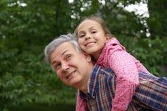 Padre allegro e figlia Fotografie Stock