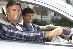 Padre On Car Journey con el hijo adolescente Fotografía de archivo libre de regalías