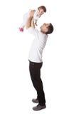 Padre che tiene piccolo bambino in alto immagine stock