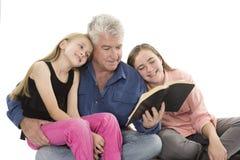 Padre con las hijas Fotografía de archivo libre de regalías