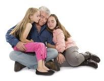 Padre con las hijas Fotografía de archivo