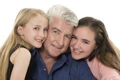 Padre con las hijas Foto de archivo libre de regalías