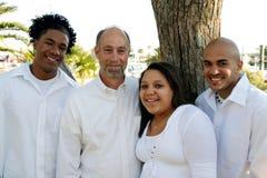 Padre con los niños adoptados de la raza mezclada Imagenes de archivo