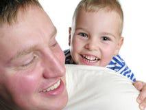 Padre de las caras con el hijo Fotos de archivo