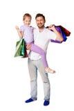 Padre e figlia felici con i sacchetti della spesa fotografia stock