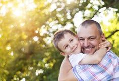 Padre e figlio felici Fotografia Stock