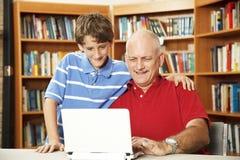 Padre e figlio in linea Fotografia Stock Libera da Diritti