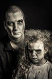 Padre e hija del zombi Foto de archivo