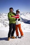 Padre e hija que disfrutan de deportes de invierno Fotos de archivo libres de regalías
