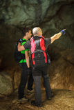 Padre e hijo en una cueva grande Fotografía de archivo libre de regalías