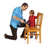 Padre e hijo - hágalo usted mismo Imagen de archivo libre de regalías