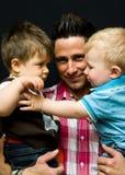 Padre e hijos Foto de archivo libre de regalías