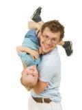 Padre felice con il piccolo gioco del figlio Fotografia Stock