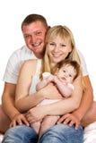 Padre feliz con la mamá y el bebé Imagen de archivo libre de regalías