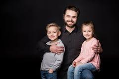 Padre feliz con los niños Imágenes de archivo libres de regalías