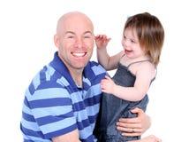 Padre hermoso con la hija linda Foto de archivo libre de regalías
