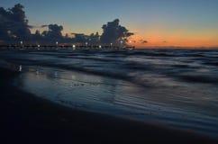 Padre Island beach lighted pier Corpus Christi, Texas. Night into morning on Padre Island beach near lighted pier Corpus Christi, Texas, just a few days before Stock Photos