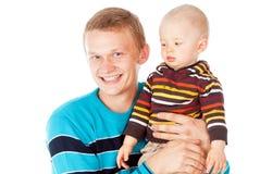 Padre joven con el bebé fotografía de archivo