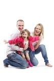 Padre, madre e hija con los brazos outstretched Imagenes de archivo