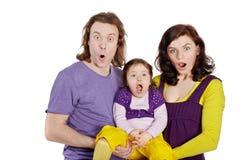 Padre, madre e hija su asimiento en las manos Fotografía de archivo libre de regalías