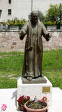 Padre Pio statue at the entrance of the town Stock Images