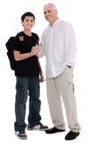 Padre que da el shakehand a su hijo Foto de archivo libre de regalías