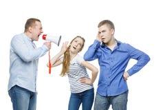 Padre que grita en los niños adolescentes Fotografía de archivo