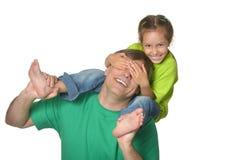 Padre que juega con su hija Fotos de archivo