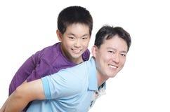 Padre que juega con su hijo Fotografía de archivo