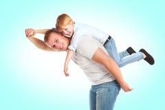 Padre que juega con su hijo Imagen de archivo