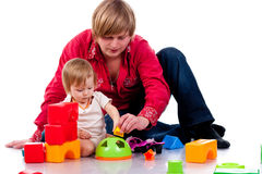 Padre que juega con un niño Imágenes de archivo libres de regalías