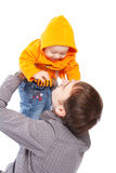 Padre que lanza para arriba al bebé Imagen de archivo