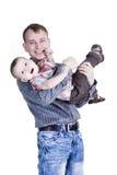 Padre sorridente con il figlio Fotografia Stock
