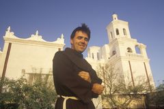 Padre stands in front of Mission San Xavier Del Bac, erected between 1783 and 1897 in Tucson Arizona Royalty Free Stock Photo