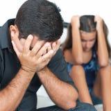 Padre triste después de discutir con su hija adolescente Fotografía de archivo libre de regalías