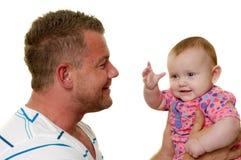 Padre y bebé sonrientes Imagenes de archivo