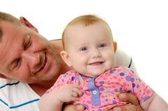 Padre y bebé sonrientes Foto de archivo libre de regalías
