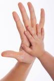 Padre y niño que hacen hola-cinco gesto Imagen de archivo