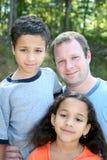 Padre y niños imagen de archivo libre de regalías