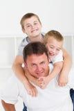 Padre y niños Imágenes de archivo libres de regalías