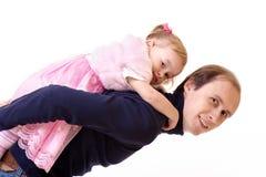 Padre y pequeña hija linda, aislados en blanco Foto de archivo
