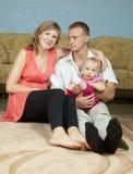 Padres con el bebé en hogar Fotografía de archivo libre de regalías