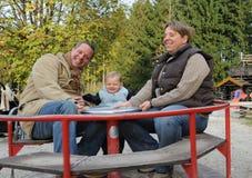 Padres con el hijo Fotos de archivo