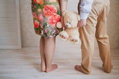 Padres con el juguete del bebé Imagen de archivo libre de regalías