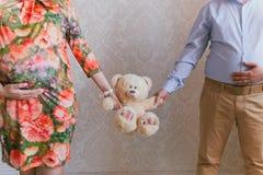 Padres con el juguete del bebé Fotografía de archivo